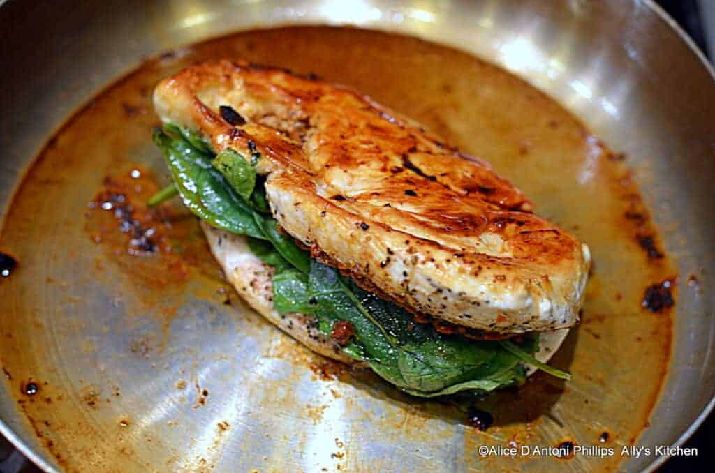 ~tomato pesto spinach stuffed grilled chicken with chunky sauce & crumbled lemon herb feta~