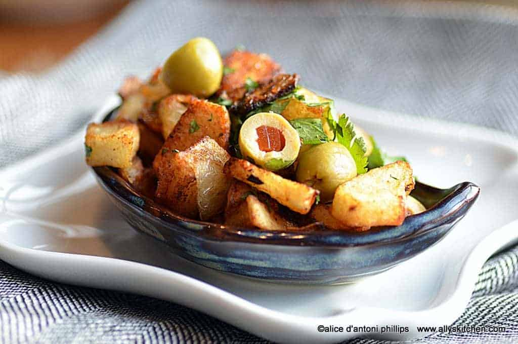 harissa fried potatoes & onions with green olives