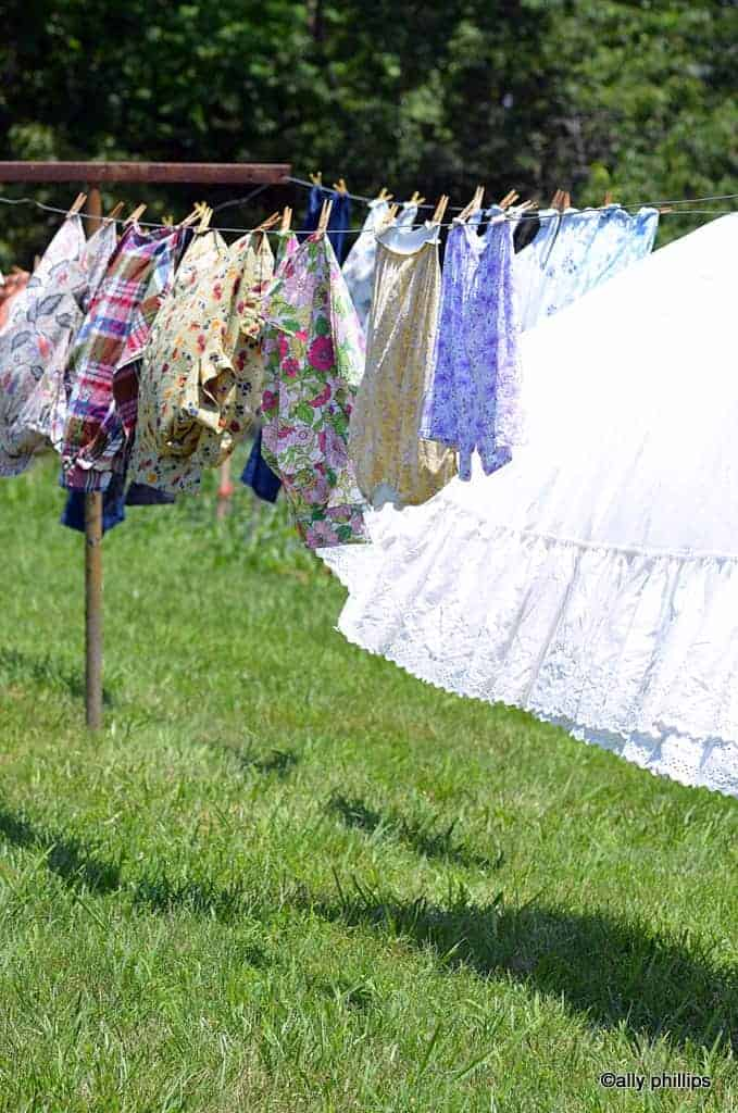 Various blouses hanging from a clothesline