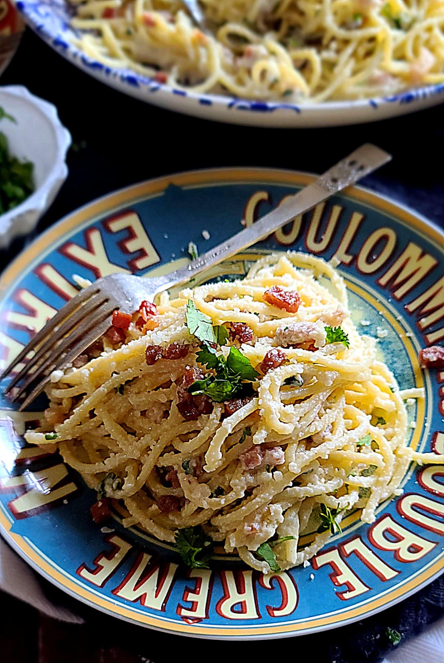 Delicious pasta carbonara on a gray plate - Italianfood.net  Delicious Pasta Carbonara